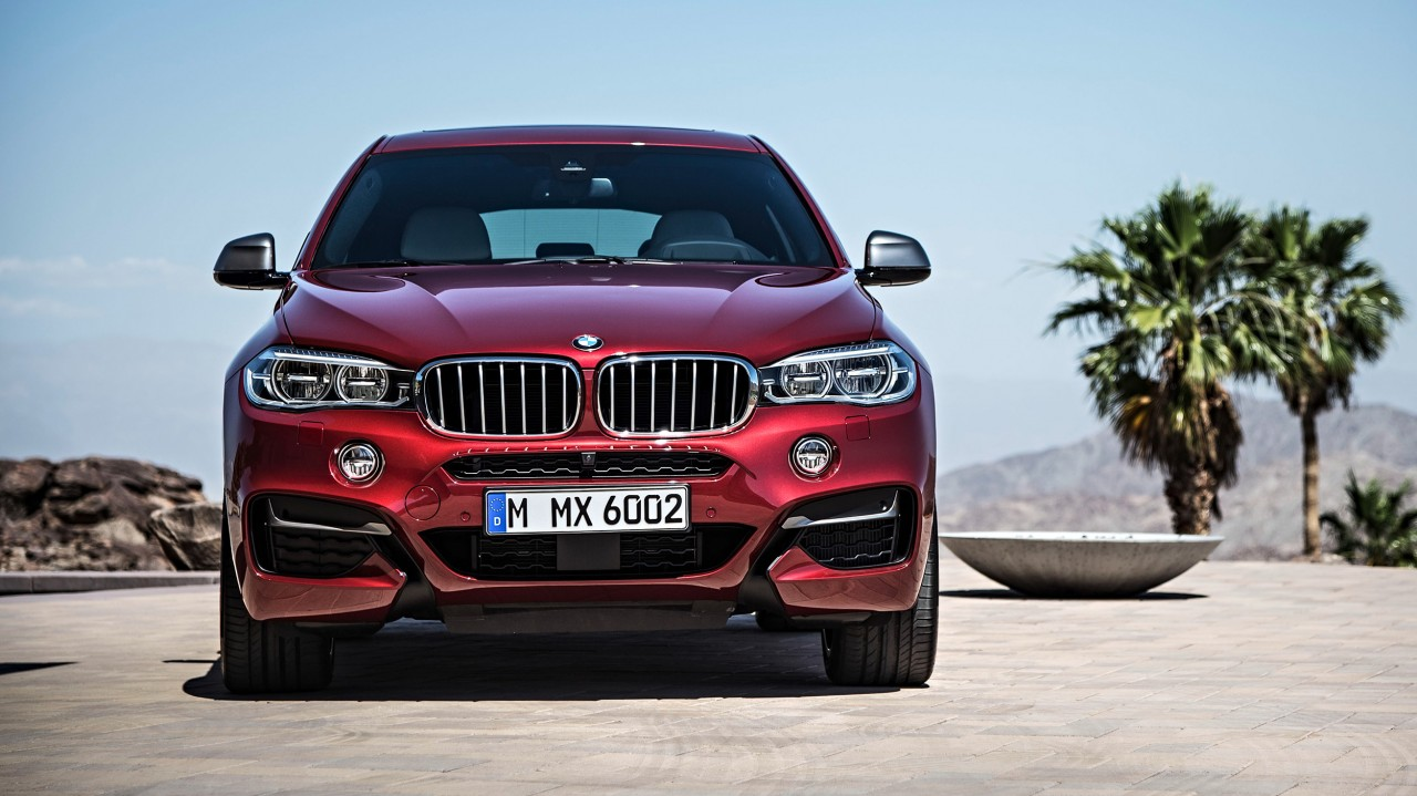 BMW X6 M50d in Flamenco Red